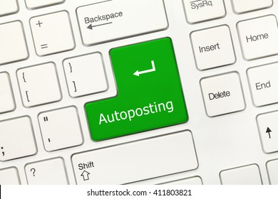 Close-up view on white conceptual keyboard - Autoposting (green key)