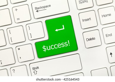 Close-up view on white conceptual keyboard - Success (green key with dollar symbol)