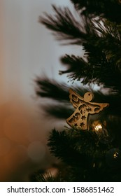 Closeup view of one beautiful christmas or new year  tree decoration of angel toy on blurred background