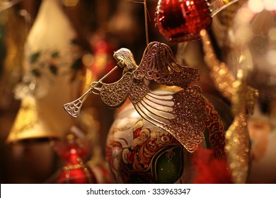 Closeup view of one beautiful christmas or new year fir tree decoration of angel toy on blurred background, horizontal picture