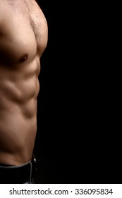 Closeup view of one handsome sexual strong young male bare chest of muscular body standing posing on studio background, vertical picture