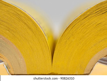Close-up view of open yellow pages book