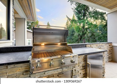 Closeup view of opened barbecue grill at outdoor patio