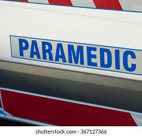 Close-up view of paramedic sign on an ambulance