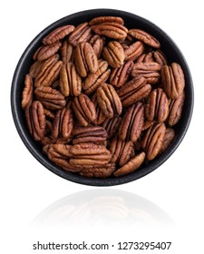 Close-up View of Pecan Kernels in a Bowl isolated on a white Background. Closeup of natural Pecan Nuts.