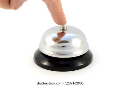 Closeup view of a person pressing the call bell for service to come.