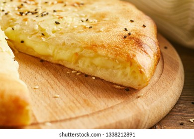 Close-up view of Pie with potato and cheese