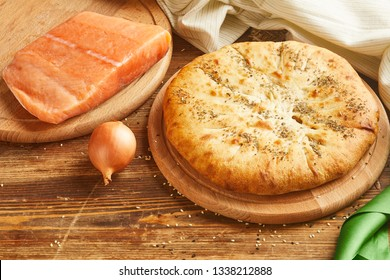 Close-up view of Pie with salmon fish and onion