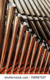 Close-up view of pipes and trumpet reed of church organ. (selective focus)