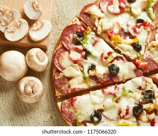 Close-up view of pizza with mushrooms, pepper, tomato and pepperoni