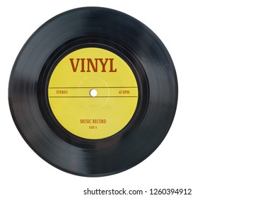 Closeup view of realistic gramophone vinyl record or phonograph record with yellow label. Black musical single play disc 7 inch 45 rpm spiral groove. Stereo sound record. Isolated on white background.
