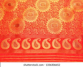 Closeup view of a red Banarasi silk sari. These exquisite, expensive sarees are famous for their gold and silver zari, brocade.