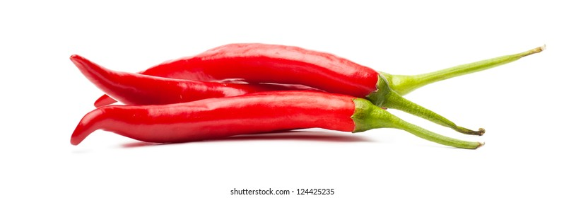 Closeup view of red chili peppers isolated over white background