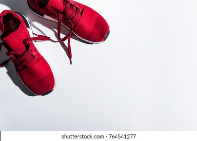 close-up view of red sports shoes isolated on grey