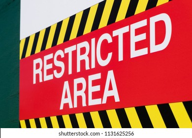 Close-up view of a restricted area sign