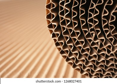 Closeup view of roll of brown corrugated cardboard, space for text. Recyclable material