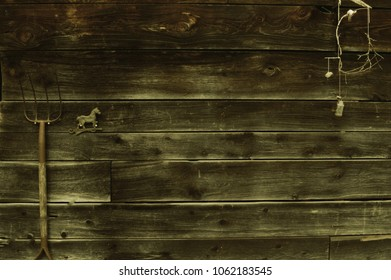 Closeup view of a rustic looking old ar wall with a few knick knacks hanging for character and appeal.