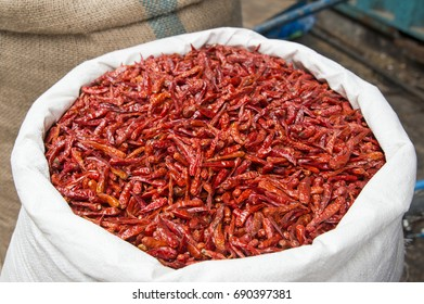 Closeup view of a sack with dry red pepper.