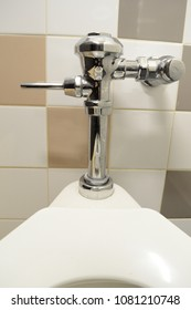 Closeup view of a sanitized toilet handle used to flush