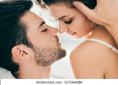 close-up view of seductive young couple able to kiss in foreplay