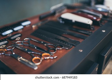 Close-up view set of professional equipment at table in barbers workplace