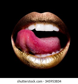 Closeup view of sexual beautiful female open golden lips with licking tongue and white teeth isolated on black background, square picture