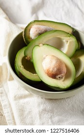 Close-up view of sliced avocado in bowl. Raw avocado. Healthy food