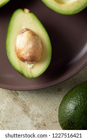 Close-up view of sliced avocado in plate. Raw avocado. Healthy food