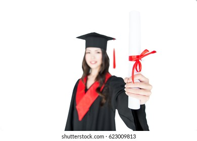 Close-up view of smiling student in graduation gown holding diploma on white