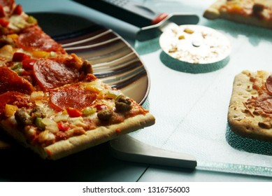 A closeup view of some fresh baked homemade pizza being served in the kitchen.