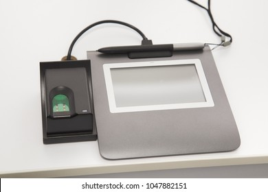 Closeup view of special modern equipment for scanning fingerprints and writing digital signature for biometric id card.