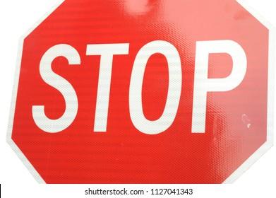Closeup view of a standard street stop sign.