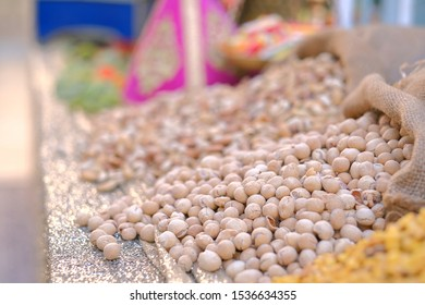 Closeup view of steamed golden groundnuts. Groundnut is scientifically known as Arachis hypogaea.Nuts mix in a canvas bag in table.Moroccan hina