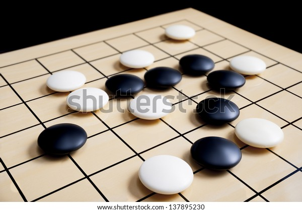 closeup view of stones on a Go board