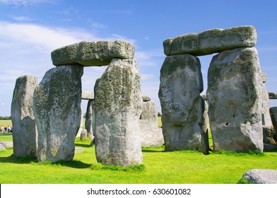 Closeup view of stones at Stonehenge. Stonehenge is a prehistoric monument in Wiltshire, England and consists of a ring of standing stones, with each around 4.1 metres high, weighing around 25 tons.