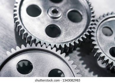 Close-up view of three gears meshing.