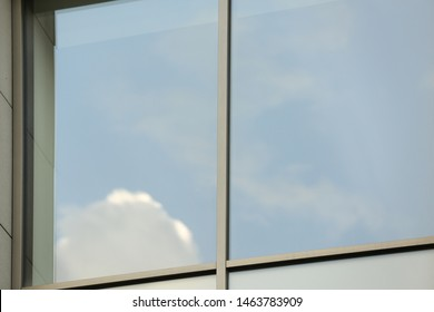 Closeup view of tinted window. Urban architecture