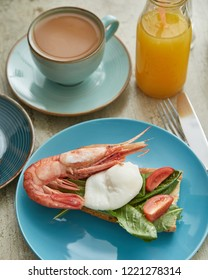 Close-up view of toast with shrimp and poached egg. Healthy food. Breakfast