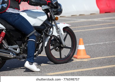 Close-up view at training motorbike with person practicing on motor-vehicle proving ground
