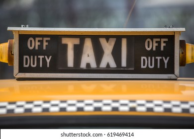 a closeup view of vintage taxi sign at big city