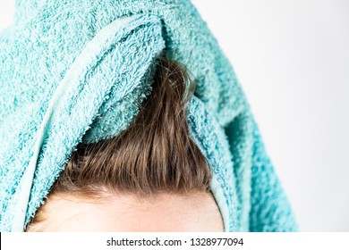 Close-up view of washed hair and bath towel. Drying hair in natural way without a blowdrier