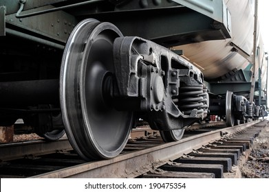 A closeup view of the wheels of a train