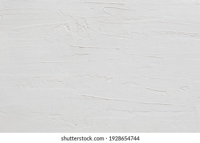 close-up view of a white stucco wall texture