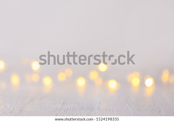Closeup view of white table with blurred lights
