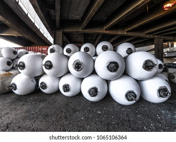 Closeup view of white water buoys or flotation markers piled up under lake shore drive bridge near Randolph Street in Chicago.