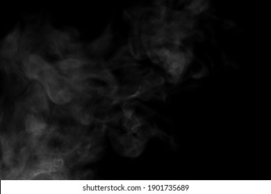 Close-up view of white water vapor with spray from the humidifier. Isolated on black background