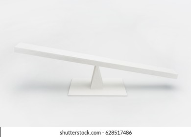 Close-up view of white wooden seesaw balancing isolated on grey