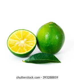 Close-up view a whole and slice cut of fresh green organic raw limes citrus and leaf isolated on white background with clipping path.