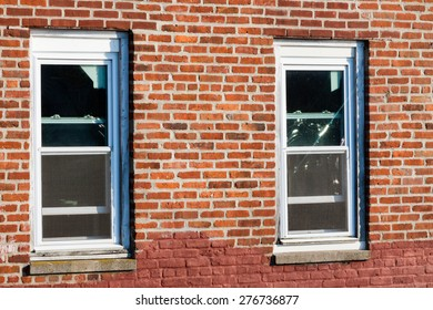close-up view of windows in a brick building