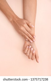 Closeup view of woman with beautiful hands on color background. Spa treatment